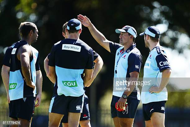 Waratahs coach Daryl Gibson speaks to players during a Waratahs Super Rugby training session at Kippax Lake on February 23 2016 in Sydney Australia