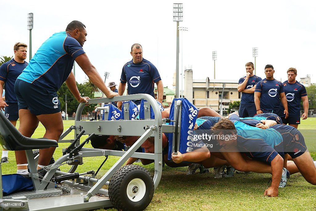 Waratahs coach Michael Cheika overlooks players packing down during a Waratahs Super Rugby training sesssion at Moore Park on January 9, 2014 in Sydney, Australia.