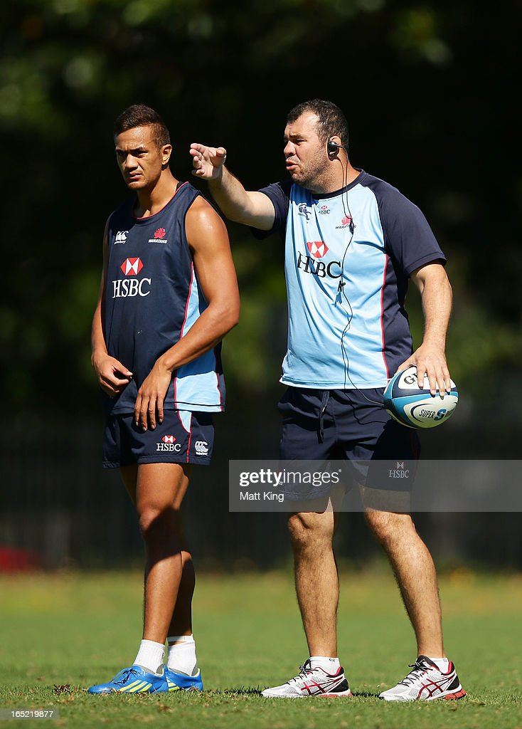 Waratahs coach Michael Cheika speaks to players as Peter Betham looks on during a Waratahs Super Rugby training session at Moore Park on April 2, 2013 in Sydney, Australia.