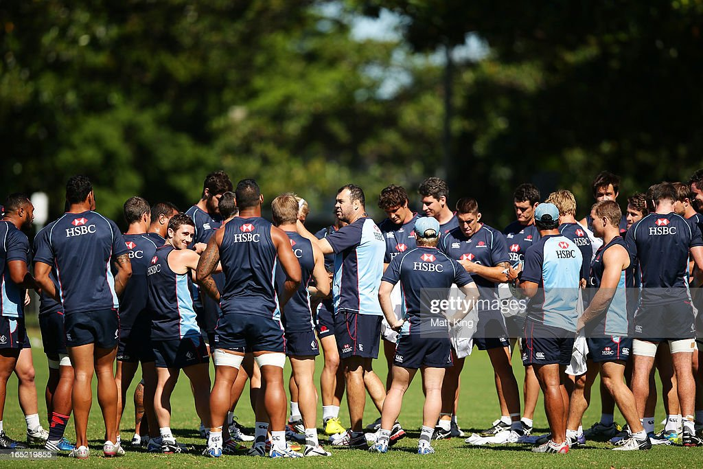 Waratahs coach Michael Cheika speaks to players during a Waratahs Super Rugby training session at Moore Park on April 2, 2013 in Sydney, Australia.
