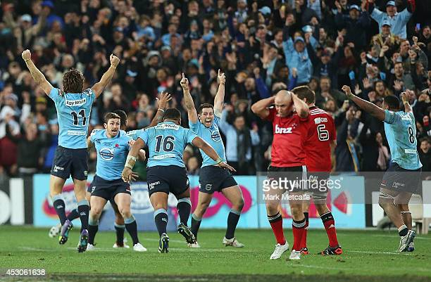 Waratahs players celebrate victory at the end of the Super Rugby Grand Final match between the Waratahs and the Crusaders at ANZ Stadium on August 2...