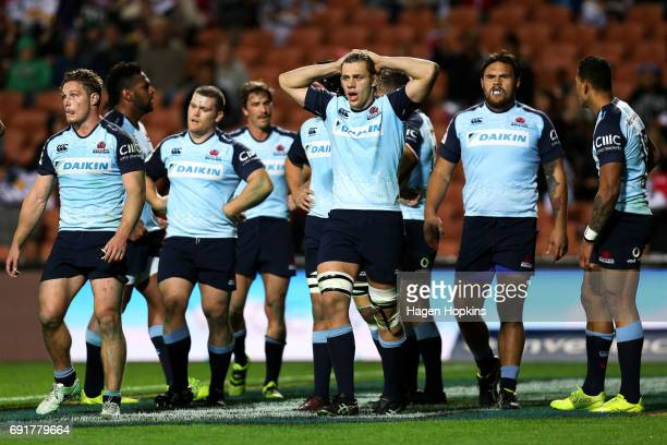 Waratahs players look on in disappointment after a Chiefs try during the round 15 Super Rugby match between the Chiefs and the Waratahs at Waikato...