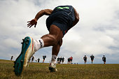 Waratahs players participate in hill sprints during a Waratahs Super Rugby preseason training session at Sydney Park on December 2 2015 in Sydney...