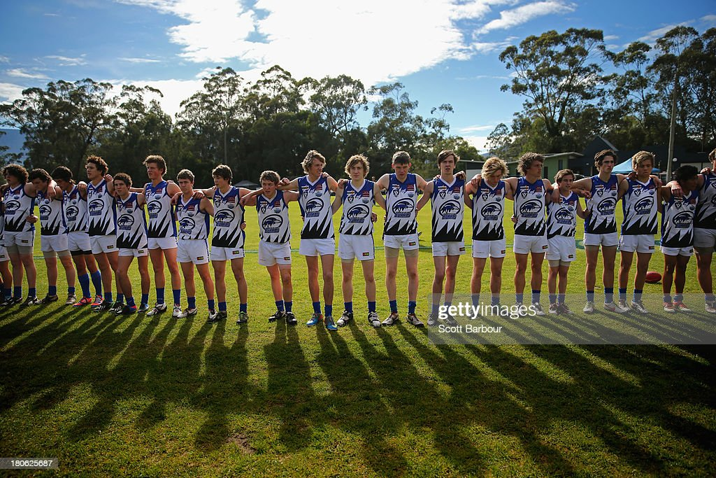 Warburton Millgrove players stand for the Australian national anthem before the start of the Yarra Valley Mountain District Football League Under 18 Grand Final between Olinda Ferny Creek and Warburton Millgrove at Yarra Junction Football Ground on September 14, 2013 in Melbourne, Australia.