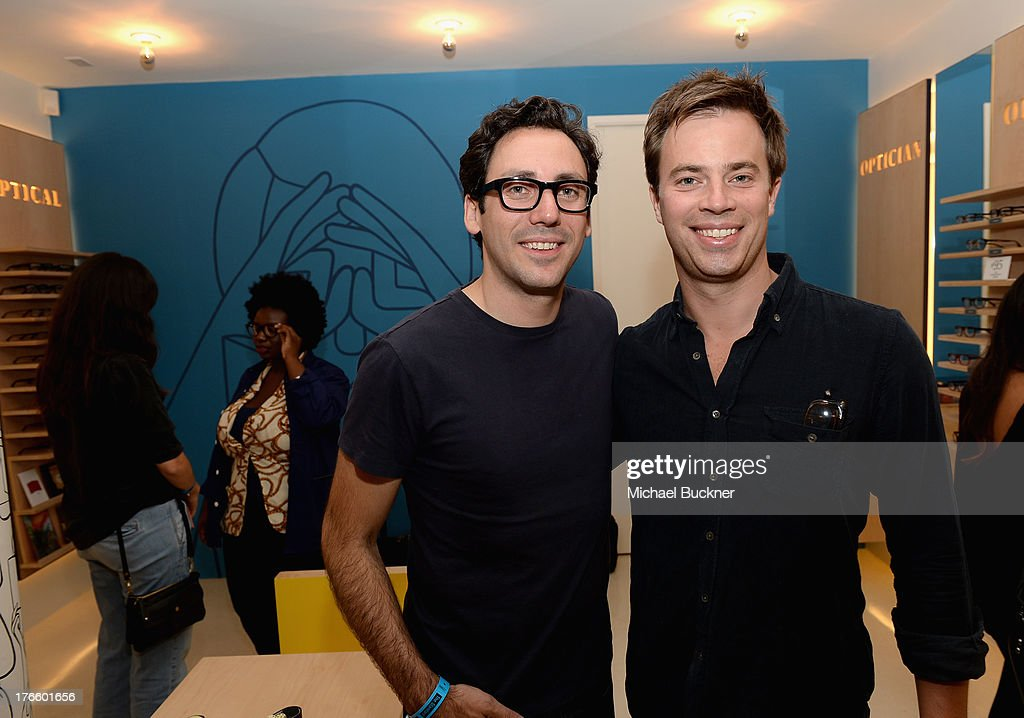 Warby Parker Co-founder and co-CEO Neil Blumenthal (L) and Warby Parker Co-founder Andy Hunt attend Warby Parker's store opening in The Standard, Hollywood on August 15, 2013 in Los Angeles, California.