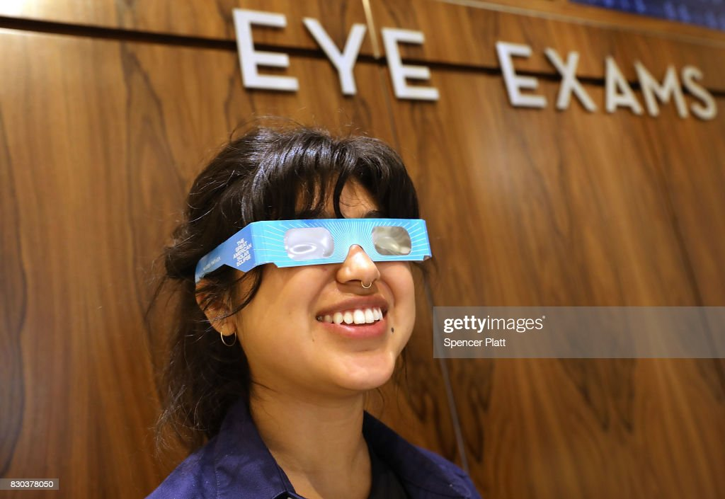 Warby Parker employee Karolyna Landin poses with a pair of solar eclipse glasses that the eyeglass store is giving out for free on August 11, 2017 in New York City. To view the upcoming total solar eclipse on August 21 eye protection is essential. The designer eyeglass store expects to give out thousands of the glasses before the event.