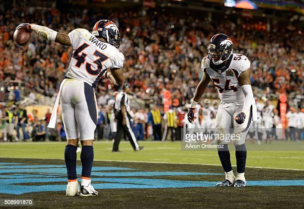 J Ward of the Denver Broncos and Brandon Marshall of the Denver Broncos celebrate a fumble recovery in the fourth quarter The Denver Broncos played...