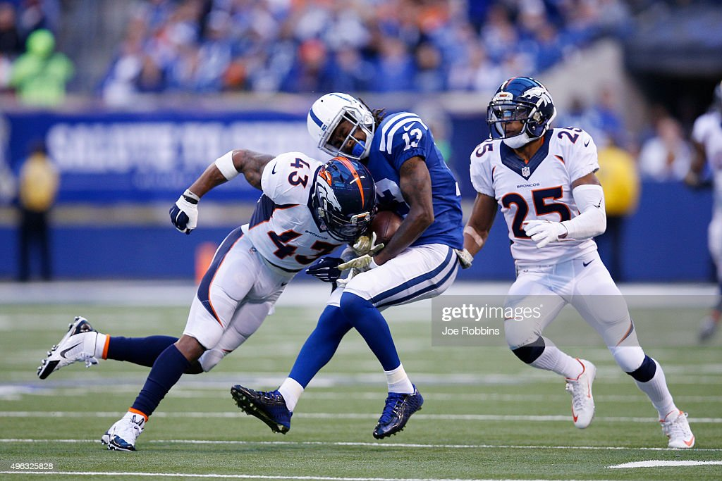Ward #43 of the Denver Broncos tackles on T.Y Hilton #13 of the Indianapolis Colts in the first quarter of the game at Lucas Oil Stadium on November 8, 2015 in Indianapolis, Indiana.