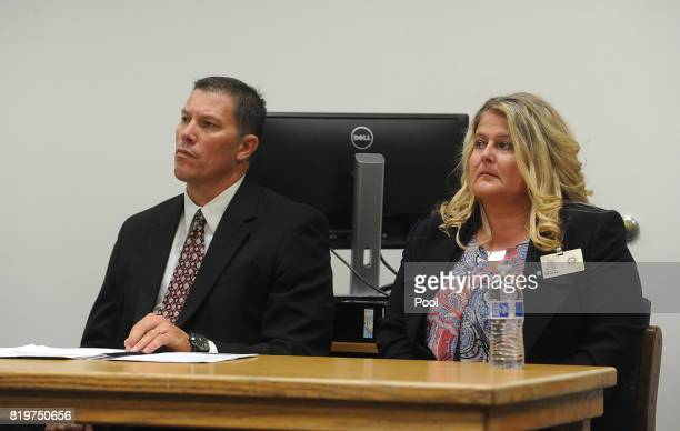 Warden Renee Baker right and caseworker Marc La Fleur listen as OJ Simpson attends a parole hearing at Lovelock Correctional Center July 20 2017 in...