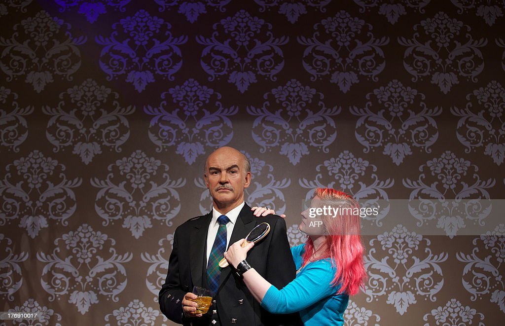 Wardrobe assistant Jane Anderson brushes a wax figure of British actor Sean Connery wearing a traditional Scottish kilt to mark his 83rd birthday on August 25 during a photo call at Madame Tussauds in central London on August 19, 2013.