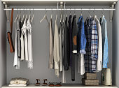 Wardrobe built-in wall with clothes 3d render