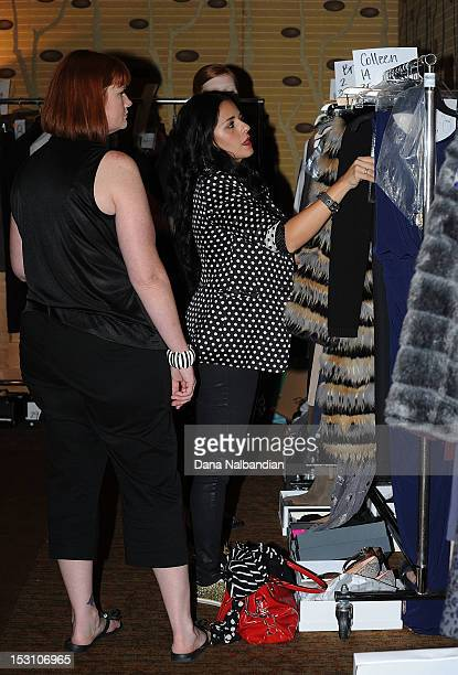 Wardrobe is checked out backstage at Fashion's Front Row presented by Vogue during Bellevue Fashion Week at the Hyatt Hotel on September 29 2012 in...