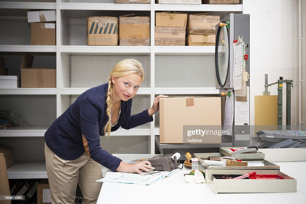 warehouse clerk checking a parcel : Stock Photo