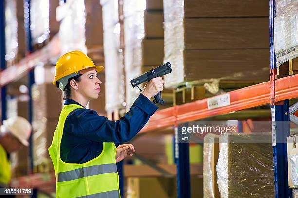 Warehouse Employee Scanning Boxes