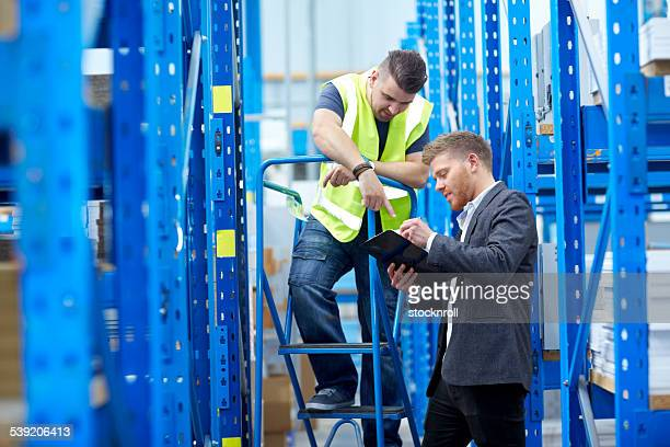 Warehouse employees checking inventory