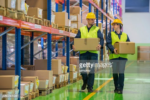 Warehouse Employees Wih Boxes