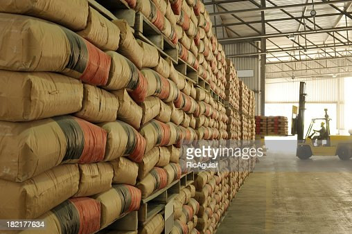 Warehouse full of sacks stacked from floor to ceiling