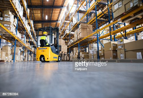 Warehouse man worker with forklift. : Foto de stock