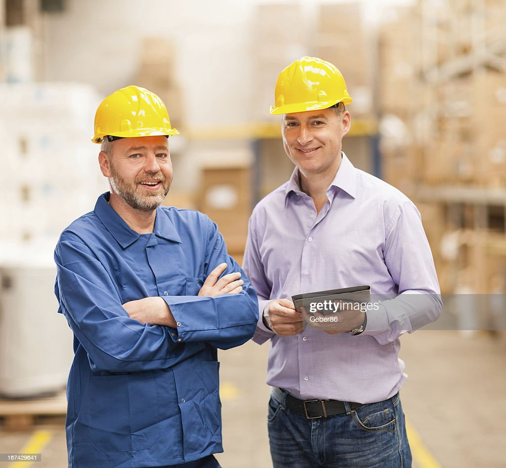 Warehouse manager and worker : Stock Photo