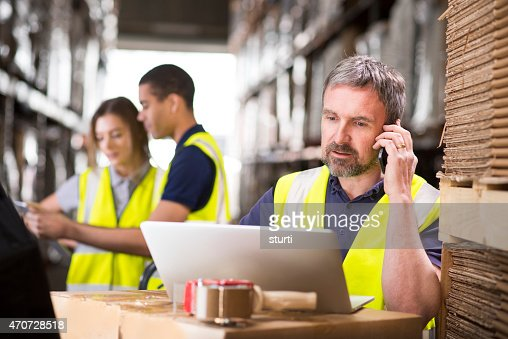 warehouse manager ringing a customer