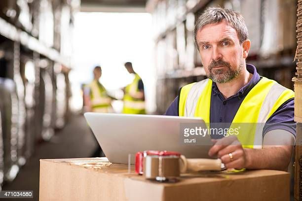 warehouse manager with serious expression.