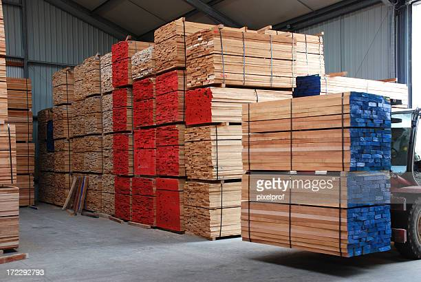 Warehouse with stacks of  boards