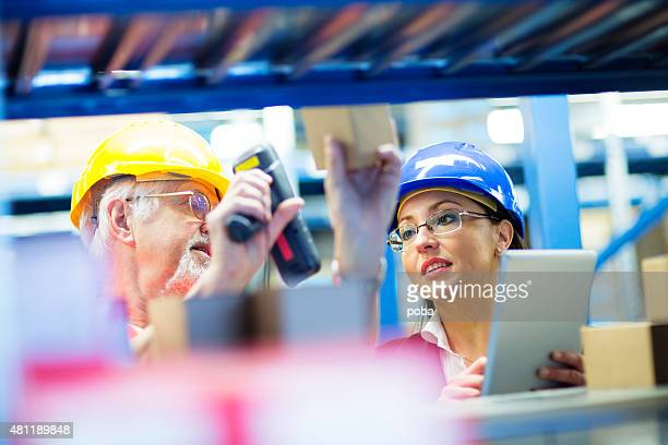 Warehouse worker and Iinspector, controller,  checking inventory