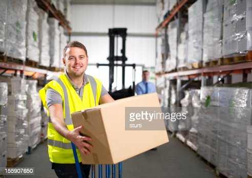 Warehouse worker loading a delivery van stock photo getty images keywords sciox Choice Image