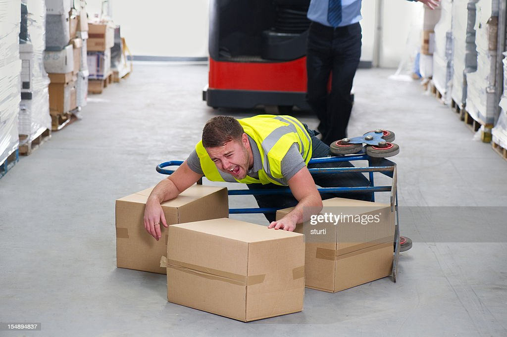 Warehouse worker dropping a stack of boxes stock photo getty images keywords sciox Choice Image