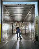 Warehouse worker  inside delivery truck