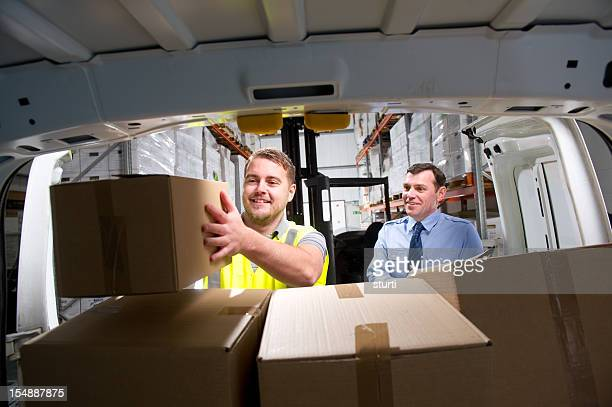 Warehouse Worker Loading a Delivery Van