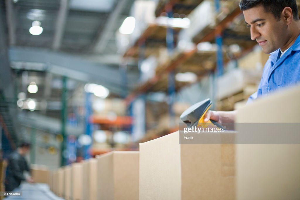 Warehouse Worker Scanning Barcode