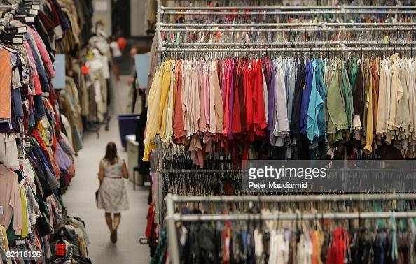 A warehouse worker walks between racks of costumes at Angels The Costumiers on July 29 2008 in London England 120 staff look after up to 4 million...