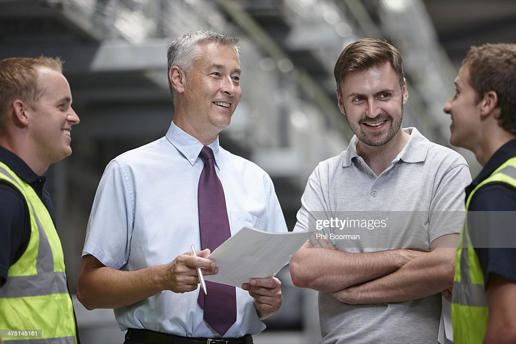 Warehouse workers and manager in engineering warehouse