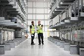 Warehouse workers in engineering warehouse