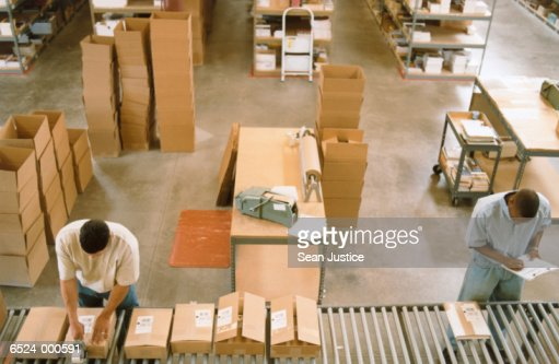 Warehouse Workers near Boxes : Stock Photo