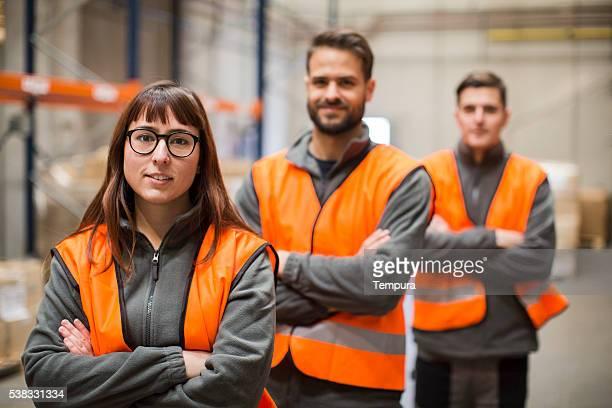 Warehouse workers portrait in work overalls
