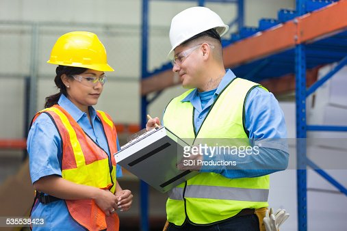 Warehouse workers talking about distribution order