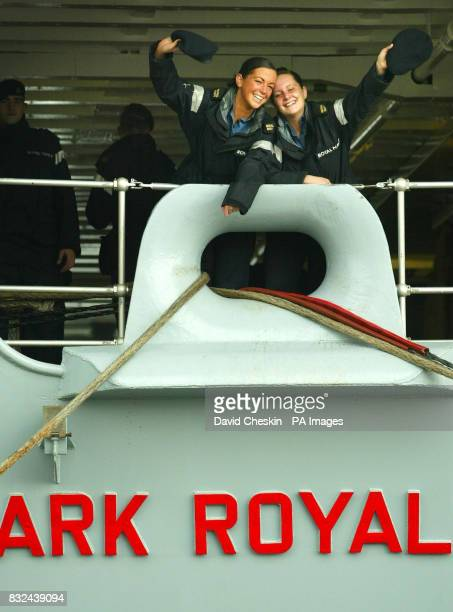 Warfare Specialists Elizabeth Dawson and Jade Bloomer wave goodbye from the deck of the HMS Ark Royal as the ship is prepared at Rosyth dockyard...