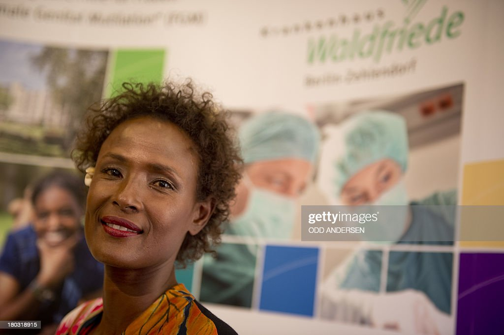 Waris Dirie, model, author, actress and human rights activist of Somali origin attends the opening of a hospital ward in Berlin on September 11, 2013. For over 12 years, Waris Dirie and her 'Desert Flower Foundation' has fought against female genital mutilation (FGM) worldwide. At least 150 million women and girls are affected by this cruel practice, which continues to be performed in Africa, but also in Asia, Europe, America and Australia. AFP PHOTO / ODD ANDERSEN