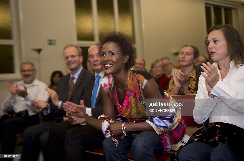 Waris Dirie, model, author, actress and human rights activist of Somali origin is applauded at the opening of a hospital ward in Berlin on September 11, 2013. For over 12 years, Waris Dirie and her 'Desert Flower Foundation' has fought against female genital mutilation (FGM) worldwide. At least 150 million women and girls are affected by this cruel practice, which continues to be performed in Africa, but also in Asia, Europe, America and Australia. AFP PHOTO / ODD ANDERSEN