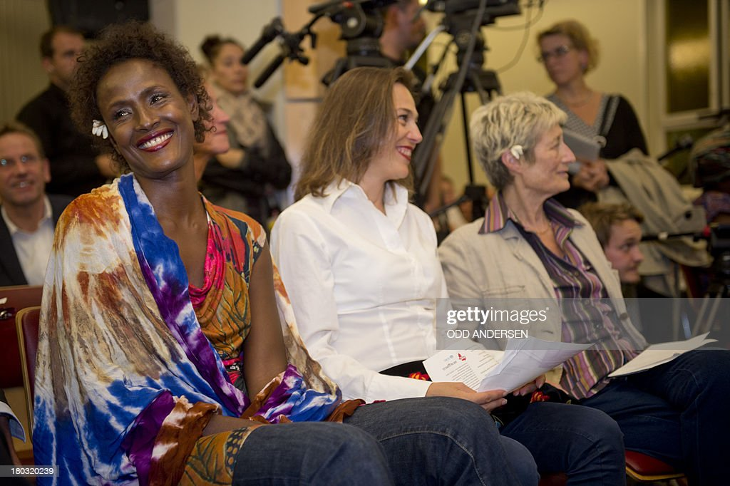 Waris Dirie (L), model, author, actress and human rights activist of Somali origin attends the opening of a hospital ward in Berlin on September 11, 2013. For over 12 years, Waris Dirie and her 'Desert Flower Foundation' has fought against female genital mutilation (FGM) worldwide. At least 150 million women and girls are affected by this cruel practice, which continues to be performed in Africa, but also in Asia, Europe, America and Australia. AFP PHOTO / ODD ANDERSEN