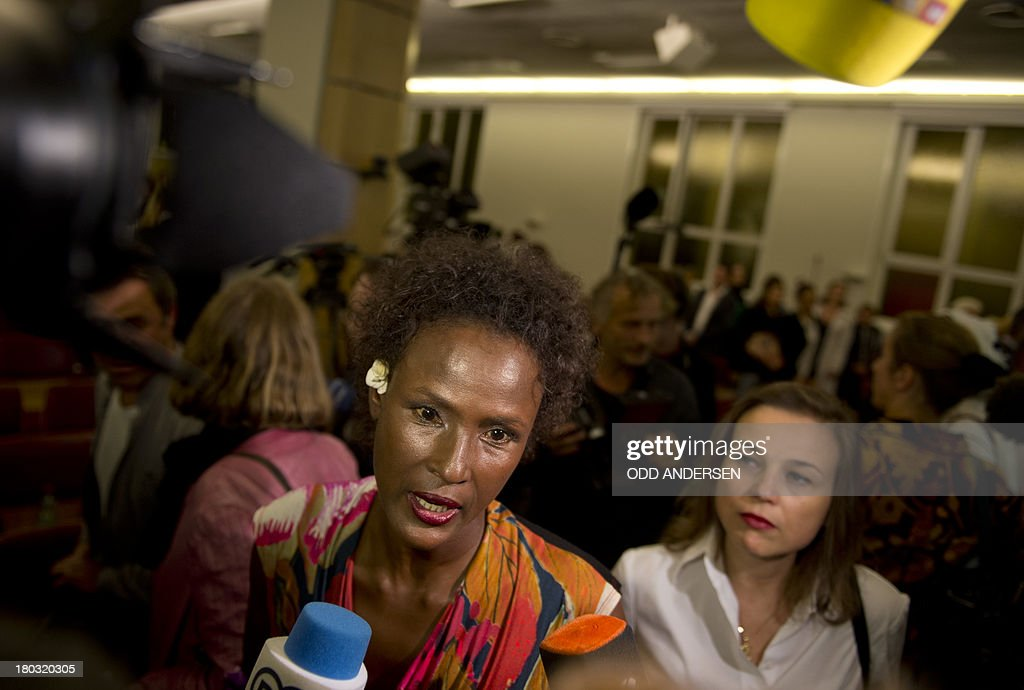 Waris Dirie, model, author, actress and human rights activist of Somali origin speaks to the media at the opening of a hospital ward in Berlin on September 11, 2013. For over 12 years, Waris Dirie and her 'Desert Flower Foundation' has fought against female genital mutilation (FGM) worldwide. At least 150 million women and girls are affected by this cruel practice, which continues to be performed in Africa, but also in Asia, Europe, America and Australia. AFP PHOTO / ODD ANDERSEN