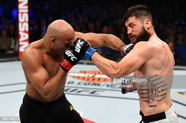 Warlley Alves of Brazil punches Bryan Barberena in their middleweight bout during the UFC 198 event at Arena da Baixada stadium on May 14 2016 in...