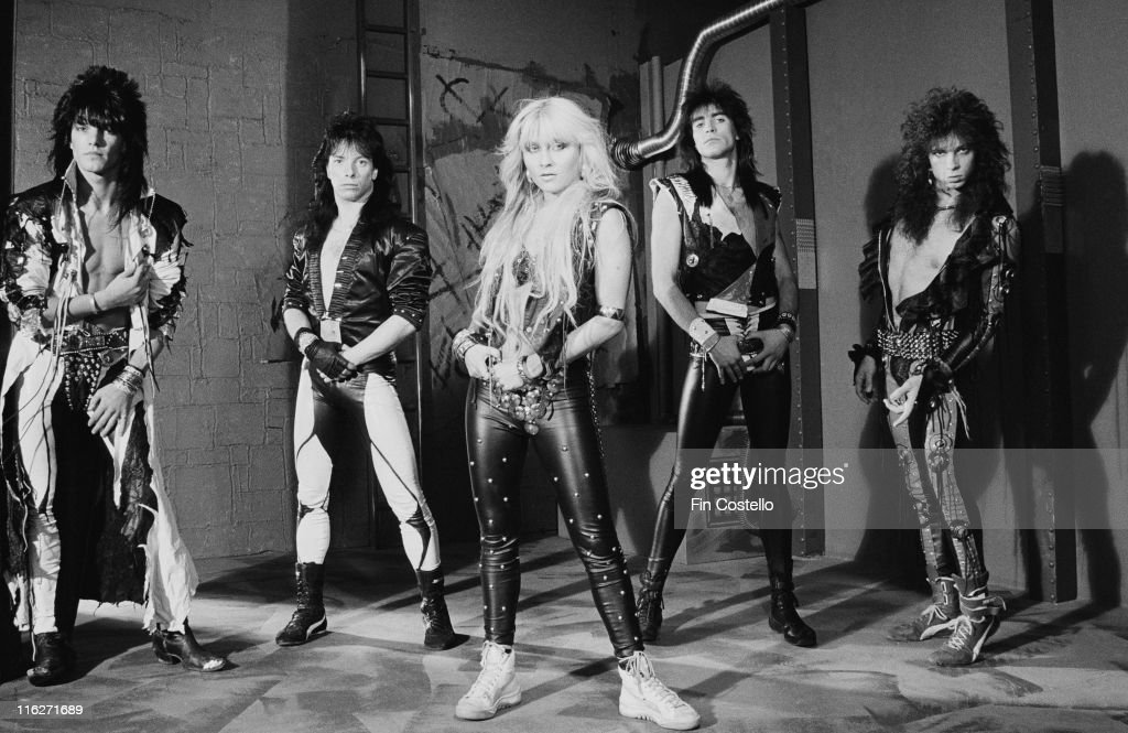 Warlock (guitarist Niko Arvanitis, singer Doro Pesch, guitarist Peter Szigeti, Bassist Frank Rittel and drummer Michael Eurich), German heavy metal band, pose for a group portrait at Rufus Street Studios, on Rufus Street, London, England, Great Britain, in August 1986.