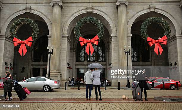 Warm and wet weather greets travelers tourists and holiday shoppers at Union Station December 23 2015 in Washington DC This December is shaping up to...