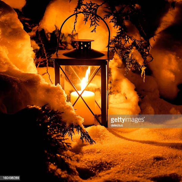Warm candlelight in the snow