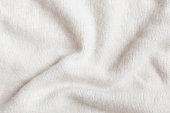 Beige crumpled cashmere wool close-up