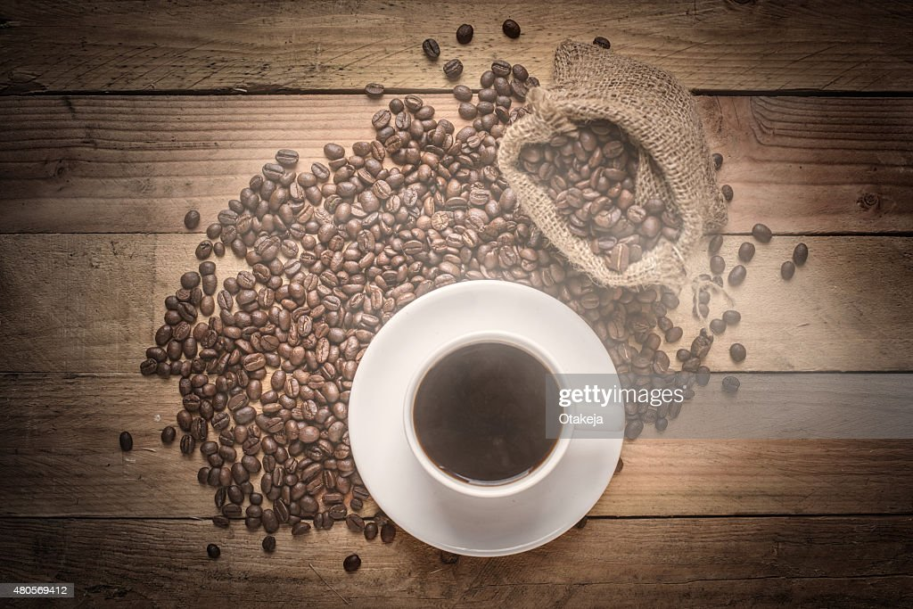 warm cup of coffee on brown background top view : Stock Photo