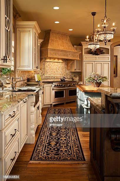 Warm elegant modern residential kitchen.